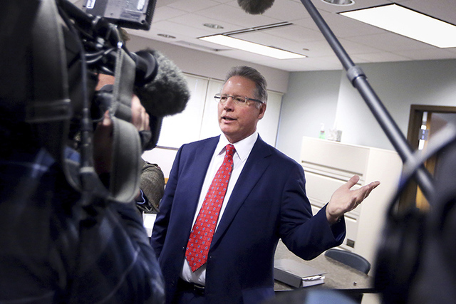 Wisconsin Elections Commission Chair Mark Thomsen addresses members of the media regarding a requested recount of the state's presidential election results following a meeting of the commission in ...