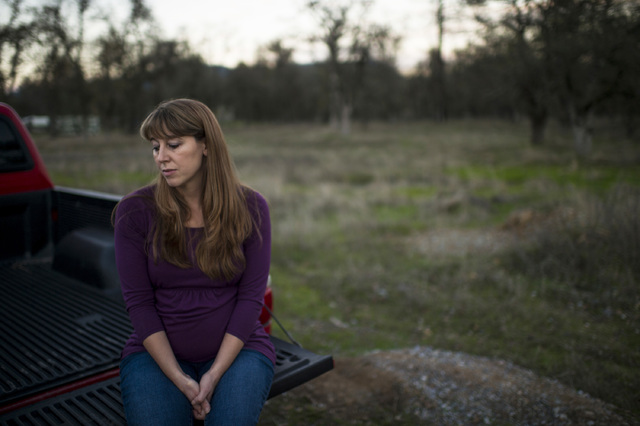 Sheila Koester sits near Sunrise Drive, where her younger sister, Sherri Papini, 34, is believed to have gone missing in Mountain Gate, Calif. (Andrew Seng/The Sacramento Bee via AP)