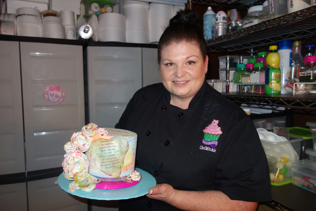 Michelle Curran displays one of her cakes. Special to View