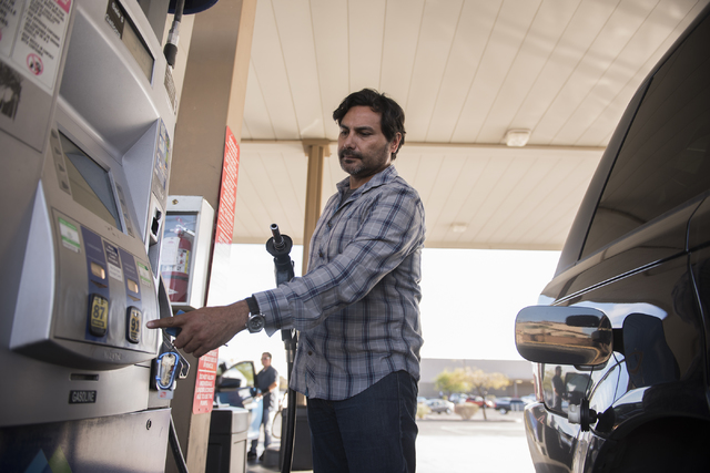 Guillermo Rangel prepares to pump gas at the Sam's Club fuel station in Las Vegas on Wednesday, Oct. 26, 2016. (Martin S. Fuentes/Las Vegas Review-Journal)
