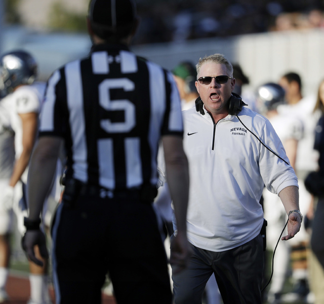 Nevada head coach Brian Polian reacts after a play against UNLV during the second half of an NCAA college football game Saturday, Nov. 26, 2016, in Las Vegas. Nevada won 45-10. (AP Photo/John Locher)