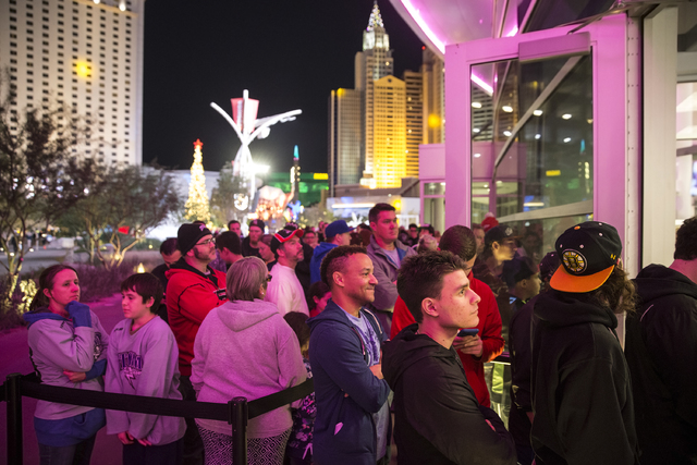Fans wait to purchase official Golden Knights merchandise at the conclusion of a ceremony to unveil the Las Vegas' NHL expansion franchise's official team nickname, logos and colors on Tuesday, No ...