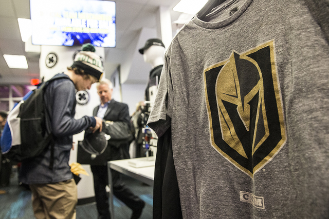 Fans purchase official Golden Knights merchandise at the conclusion of a ceremony to unveil the Las Vegas' NHL expansion franchise's official team nickname, logos and colors on Tuesday, Nov. 22, 2 ...