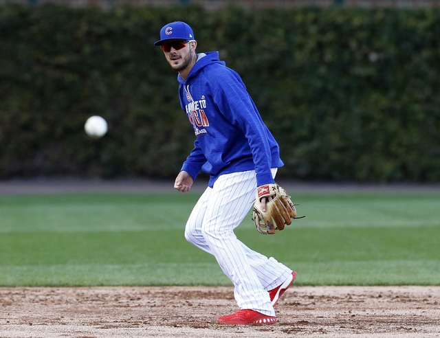 Chicago Cubs' Kris Bryant takes fielding practice during a team workout in preparation for Saturday's Game 1 in baseball's National League Championship Series in Chicago, Thursday, Oct. 13, 2016.  ...