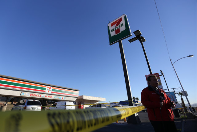A television reporter gets ready to go on camera as North Las Vegas police investigate a fatal shooting at a 7-Eleven in North Las Vegas on Thursday, Nov. 10, 2016. (Brett Le Blanc/Las Vegas Revie ...