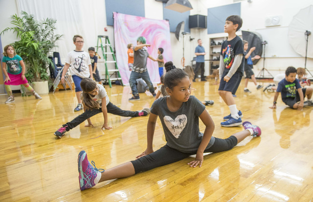 Amaya Green, third-grader, attends a learning arts class at Gilbert Magnet  School