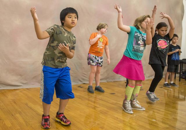 Third-grader Airrik Sojot attends a learning arts class at Gilbert Magnet School Oct. 11, 2016. The class is part of Cirque du Soleil's Arts Nomades program. Jacob Kepler/View