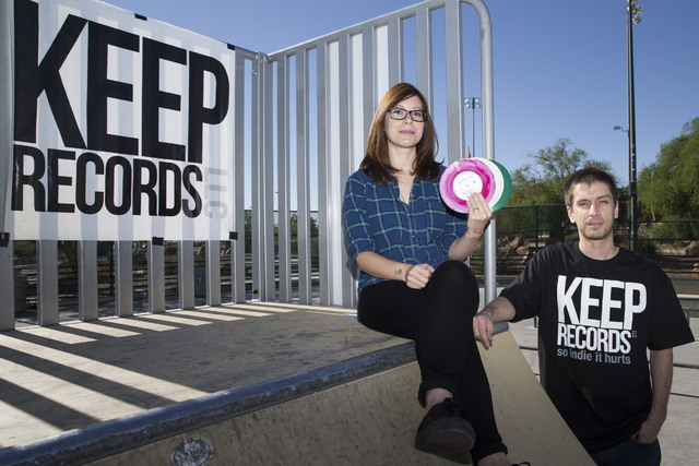 Julia Pasillas and her husband, Roger Tiborczszeghy, owners of Keep Records, LLC, with records from Roger's personal music collection at Mountain Ridge Skate Park Oct. 21, 2016, in Las Vegas. Erik ...