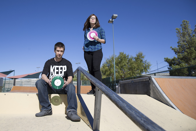 Roger Tiborczszeghy and his wife, Julia Pasillas, owners of Keep Records, LLC, with records from Roger's personal music collection at Mountain Ridge Skate Park Oct. 21, 2016, in Las Vegas. Erik Ve ...