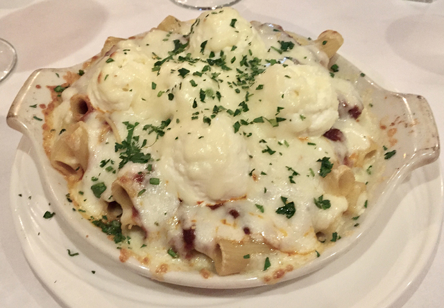 Baked rigatoni (rigatoni pasta mixed with meat sauce, ricotta and mozzarella) is served at Nora's Italian Cuisine, 5780 W. Flamingo Road. The family-run restaurant recently moved to its new 6,800- ...