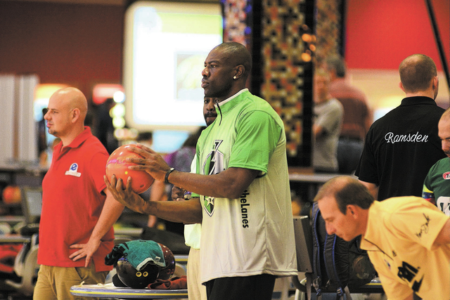 Terrell Owens participates in a practice session for the PBA World Series of Bowling on Friday at South Point Bowling Center, where the event will run through Nov. 3. Owens, 39, a 15-year NFL vete ...
