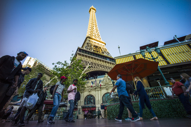 People walk along the Las Vegas Strip outside of the Paris hotel-casino on Friday, Nov. 4, 2016. The hotel-casino experience a massive power outage on Thursday. Chase Stevens/Las Vegas Review-Jour ...