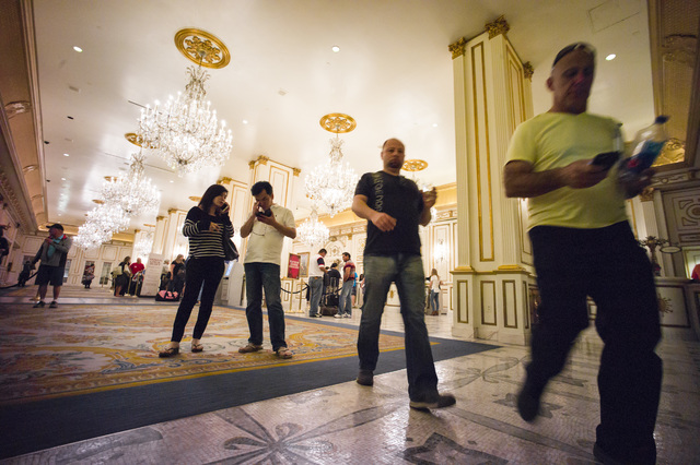 Hotel guests walk through the lobby of the Paris hotel-casino in Las Vegas on Friday, Nov. 4, 2016. The hotel-casino experience a massive power outage on Thursday. Chase Stevens/Las Vegas Review-J ...