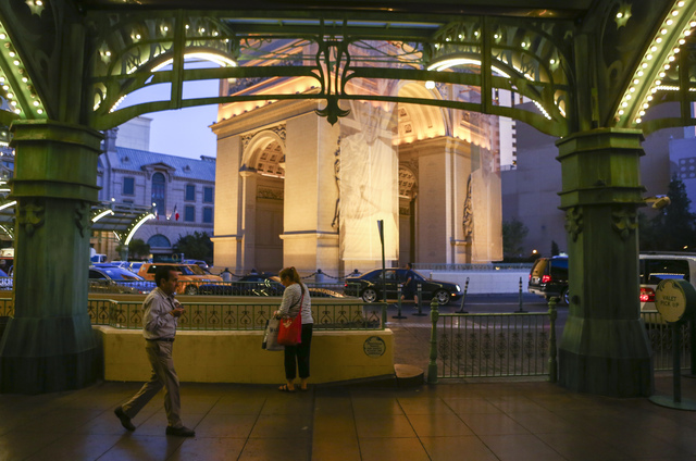 People walk outside of the Paris hotel-casino in Las Vegas on Friday, Nov. 4, 2016. The hotel-casino experience a massive power outage on Thursday. Chase Stevens/Las Vegas Review-Journal Follow @c ...