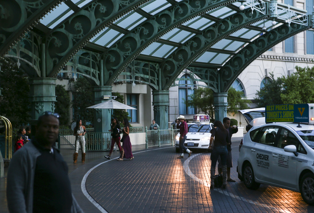 Hotel guests arrive at the Paris hotel-casino in Las Vegas on Friday, Nov. 4, 2016. The hotel-casino experience a massive power outage on Thursday. Chase Stevens/Las Vegas Review-Journal Follow @c ...