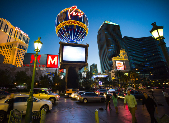 People Walk Outside Of The Paris Hotel Casino In Las Vegas On Friday Nov