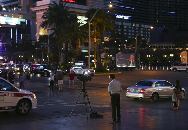 A member of the news media broadcasts outside of the Paris hotel-casino in Las Vegas on Friday, Nov. 4, 2016. The hotel-casino experience a massive power outage on Thursday. Chase Stevens/Las Vega ...
