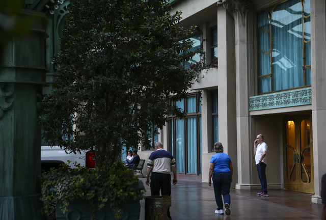 Hotel guests stand outside of the Paris hotel-casino in Las Vegas on Friday, Nov. 4, 2016. The hotel-casino experience a massive power outage on Thursday. Chase Stevens/Las Vegas Review-Journal Fo ...