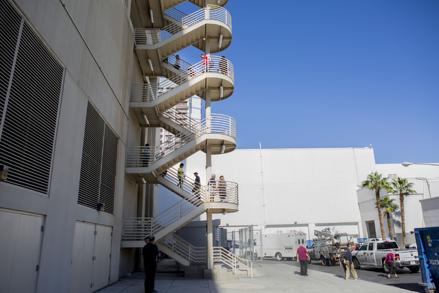 People walk up the staircase of the Paris hotel-casino  self-parking ramp instead of taking elevators due to the power outage in Las Vegas on Thursday, Nov. 3, 2016.  (Elizabeth Page Brumley/Las V ...