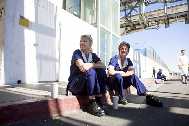 Dzana Odobasic, left, and Hida Dudundzic, Paris hotel-casino employees wait outside of the establishment for updates of the power outage on Thursday, Nov. 3, 2016, in Las Vegas. (Elizabeth Page Br ...