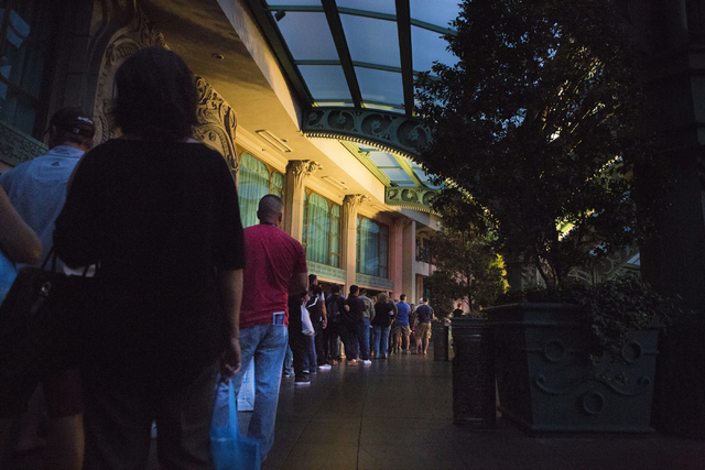 Guests of the Paris hotel-casino wait in line to be escorted to retrieve their belongings from their rooms, Thursday evening, Las Vegas, Nov. 3, 2016, after the power outage.   Elizabeth Page Brum ...