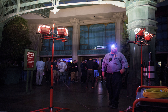 Temporary lights are set up for the guests of the Paris hotel-casino wait in line to be escorted to retrieve their belongings from their rooms Thursday evening, Las Vegas, Nov. 3, 2016. Elizabeth  ...