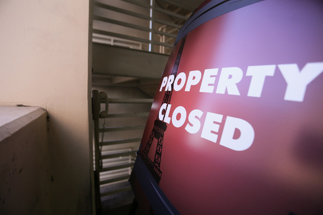 """A """"closed"""" sign faces a wall in the parking garage of the Paris Las Vegas on Friday, Nov. 4, 2016, after power outages forced the evacuation of the hotel-casino Thursday. (Brett Le Blanc/Las Vegas ..."""