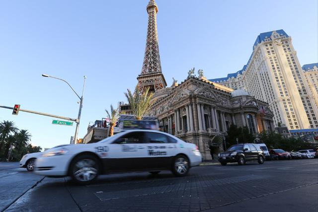 A taxi pulls away from the Paris Las Vegas on Friday, Nov. 4, 2016. (Brett Le Blanc/Las Vegas Review-Journal Follow @bleblancphoto)