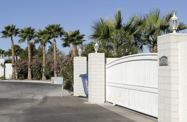 A gated house at 3346 Smoke Tree Lane near Sunset Park in Las Vegas is seen Monday, Nov 7, 2016. Residents in the area say that peacocks routinely swarm the area causing a nuisance. (Bizuayehu Tes ...