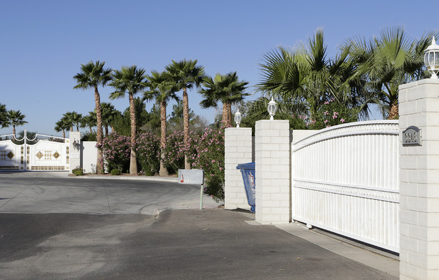 A gated house, right, at 3346 Smoke Tree Lane near Sunset Park in Las Vegas is seen Monday, Nov 7, 2016. Residents in the area say that peacocks routinely swarm the area causing a nuisance. (Bizua ...