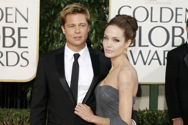 c743297a Brad Pitt, and actress Angelina Jolie arrive for the 64th Annual Golden  Globe Awards in