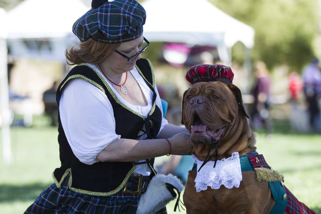 Catherine Baudoux gets her dog Lucy ready for the Halloween costume contest during the Family, Fur and Fun Festival at Exploration Park on Saturday, Oct. 15, 2016, in Las Vegas. (Erik Verduzco/Las ...