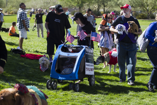 People display their dogs in Halloween costumes for a contest during the Family, Fur and Fun Festival at Exploration Park on Saturday, Oct. 15, 2016, in Las Vegas. (Erik Verduzco/Las Vegas Review- ...