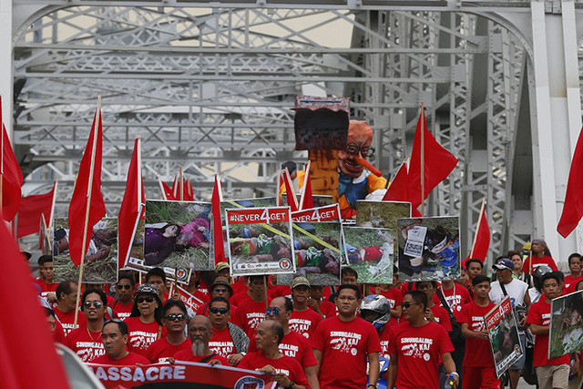 Philippine journalists march toward the Presidential Palace to commemorate the sixth anniversary of the massacre of 58 people, including 32 journalists. (Bullit Marquez/AP)