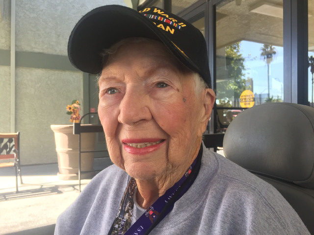 World War II Navy veteran Irene Miller, 95, poses for a photo, Thursday, Nov. 3, 2016, while waiting for a van outside a retirement living complex on East Tropicana Avenue in Las Vegas. (Keith Rog ...