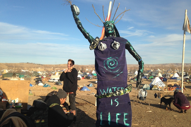 A sculpture stands at an encampment where protesters of the Dakota Access oil pipeline have been gathered for months. Protest organizers said that they have a right to stay on the land. Their stat ...