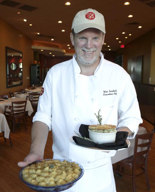 Chef Wes Kendrick of Table 34 poses for a photo holding turkey shepherd's pie, left, and turkey pot pie inside his restaurant Thursday, Nov. 17, 2016. Bizuayehu Tesfaye/Las Vegas Review-Journal Fo ...