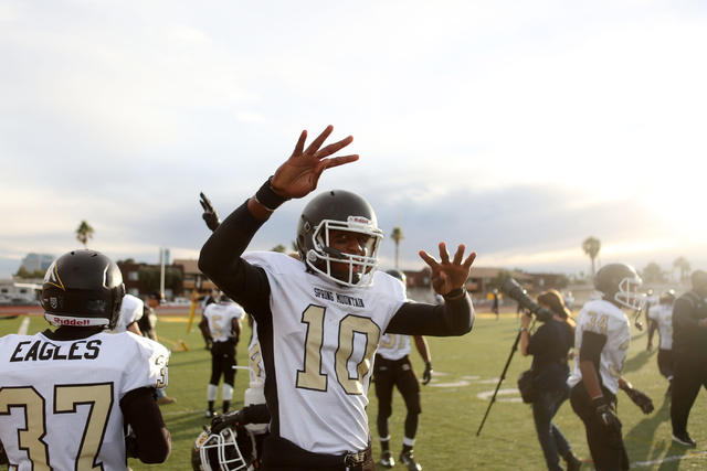 Spring Mountain's Randell Mosely (10), celebrates after his team scored another touchdown in the last quarter of the game, securing their victory during the class 1A state football final neutral p ...