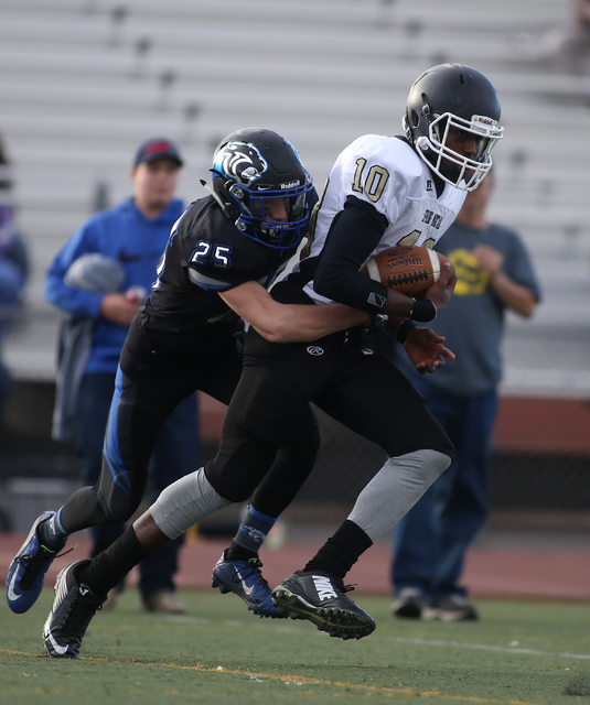 Spring Mountain's Randell Mosely (10), runs with the ball during the class 1A state football final neutral playoff game against Pahranagat Valley at Clark High School in Las Vegas, Saturday, Nov.  ...