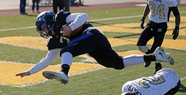 Pahranagat Valley's Quarterback Tabor Maxwell (2), dives with the ball during the class 1A state football final neutral playoff game against Spring Mountain at Clark High School in Las Vegas, Satu ...