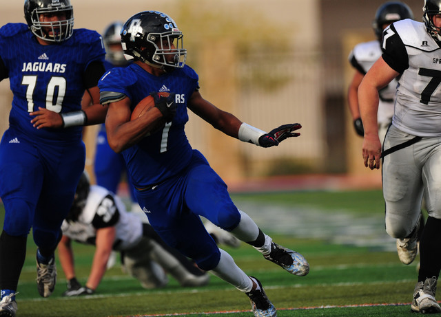 Desert Pines wide receiver Tony Fields looks for running room, after catching a first down pass against Spring Creek in the second half of the NIAA Class 3A State championship game at Bishop Gorma ...