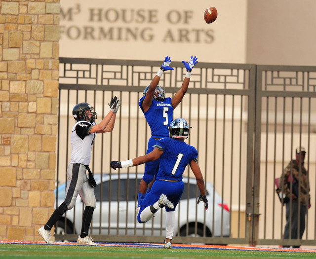 Desert Pines safety Eddie Heckard (5) intercepts a  Spring Creek pass in the endzone in the second half of the NIAA Class 3A State championship game at Bishop Gorman High School in Las Vegas Satur ...