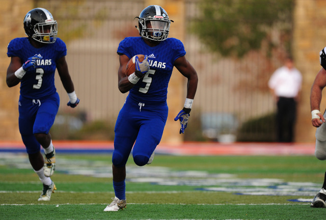 Desert Pines safety Eddie Heckard (5) returns a Spring Creek interception for a touchdown in the second half of the NIAA Class 3A State championship game at Bishop Gorman High School in Las Vegas  ...