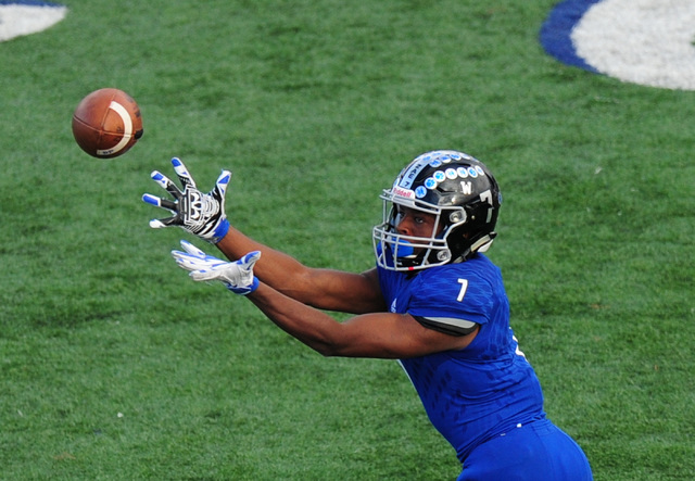 Desert Pines wide receiver Isaiah Morris catches a pass against Spring Creek in the second half of the NIAA Class 3A State championship game at Bishop Gorman High School in Las Vegas Saturday, Nov ...