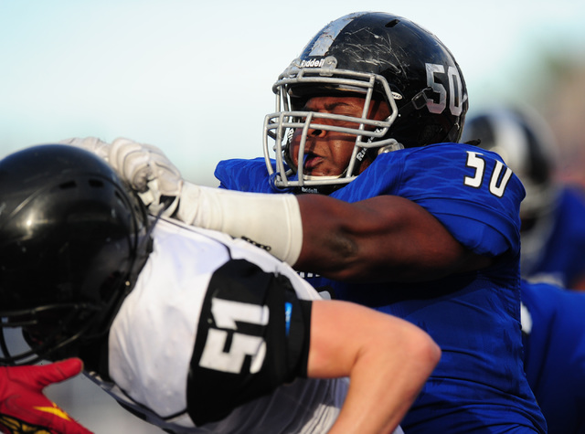 Desert Pines linebacker Tyree Wright, right, pushes Spring Creek linebacker Logan Thurston in the second half of the NIAA Class 3A State championship game at Bishop Gorman High School in Las Vegas ...