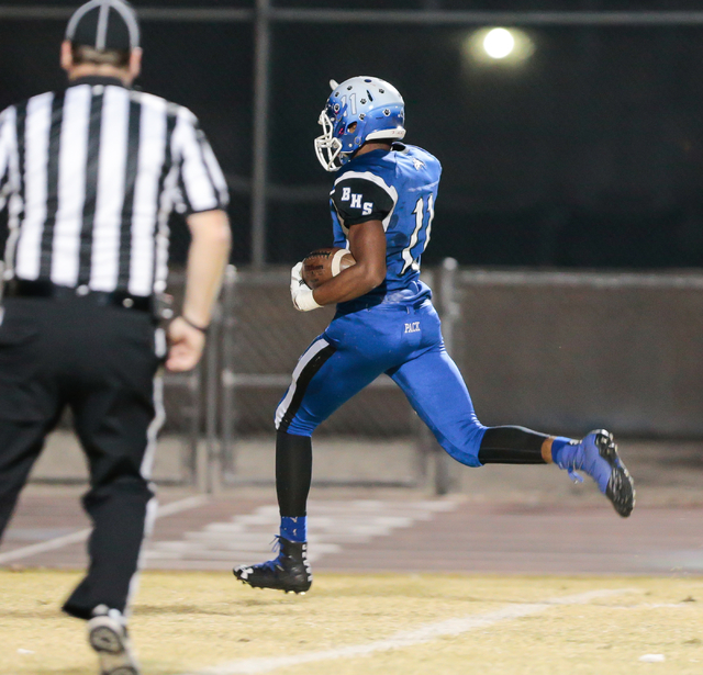 Basic senior Frank Harris (11) runs the ball in for a touchdown in a matchup against Foothill High School during  the Sunrise Region semifinal football game held at Basic High School in Henderson, ...