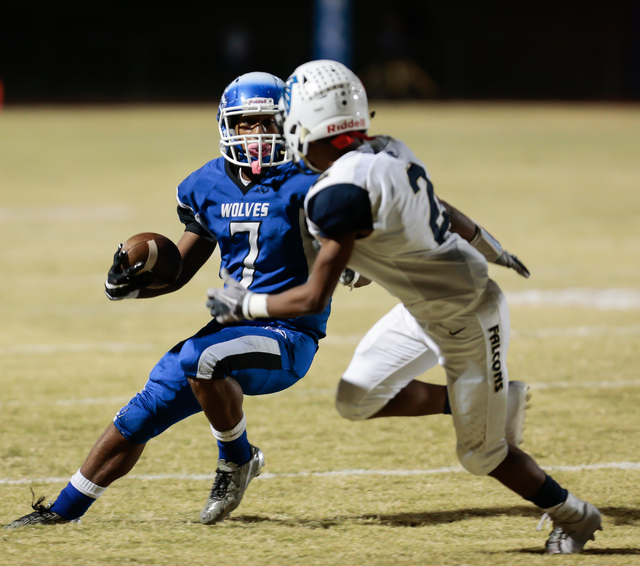 Basic sophomore Dorian McAllister (7) does some fast leg work in an attempt to avoid Foothill senior Marquies Jerkins (2) during  the Sunrise Region semifinal football game held at Basic High Scho ...