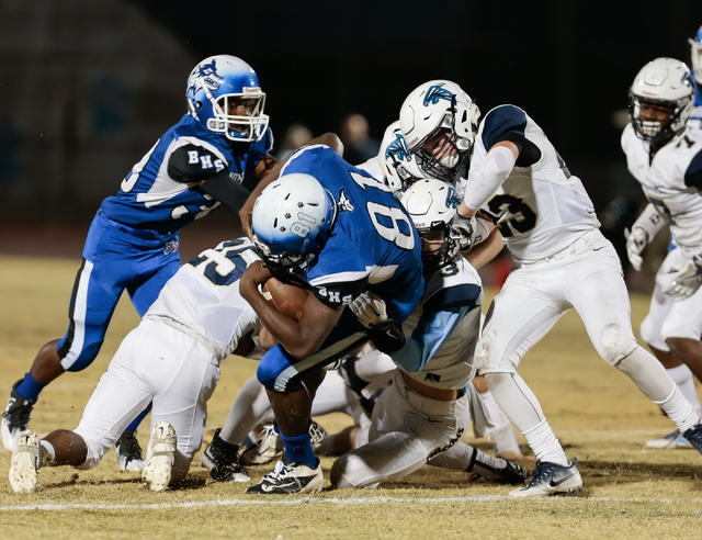Basic freshman Darnell Washington (81) works his way forward with the ball, while being restrained by the Foothill High School defense during  the Sunrise Region semifinal football game held at Ba ...