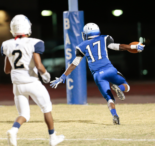 Basic senior Quison Owens (17) raises his arms with the ball as he runs the ball in for a touchdown while Foothill senior Marquies Jerkins (2) looks on during  the Sunrise Region semifinal footbal ...