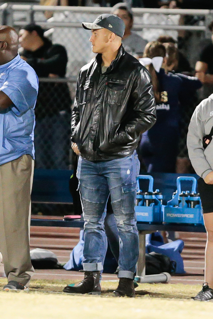 Foothill High School graduate and Detroit Lions football player Mile Killebrew, is shown watching the game on the sidelines between his alma matter and Basic High School  during  the Sunrise Regio ...